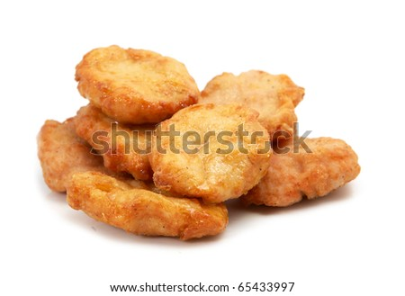 Studio shooting of a fried chicken pieces (mcnuggets) on white background - stock photo