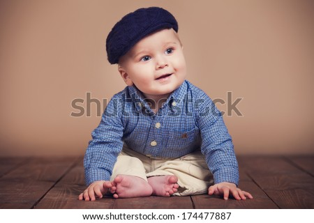 Studio shot a happy-looking baby posing for the camera - stock photo