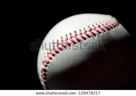 Studio shot of a baseball ball, black background - stock photo