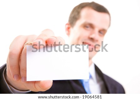 Studio shot of a businessman holding out a blank business card. Room for text, or your own message. - stock photo
