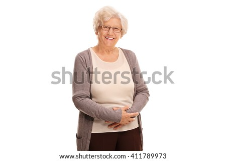 Studio shot of a cheerful old lady smiling and looking at the camera isolated on white background - stock photo