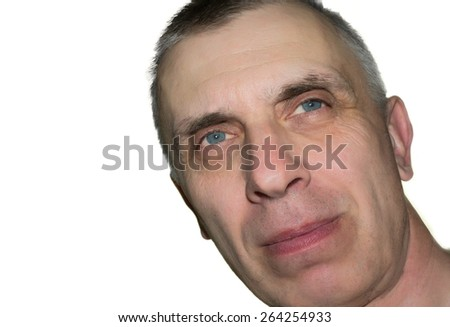 Studio shot of a dreamily looking man with a tilted head, isolated on white - stock photo