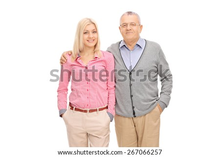 Studio shot of a father and daughter posing hugged isolated on white background - stock photo