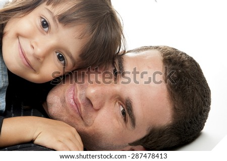 Studio shot of a father and his daughter - stock photo