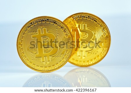 Studio shot of a golden Bitcoin (new virtual money ) Close-up on a blue background. - stock photo