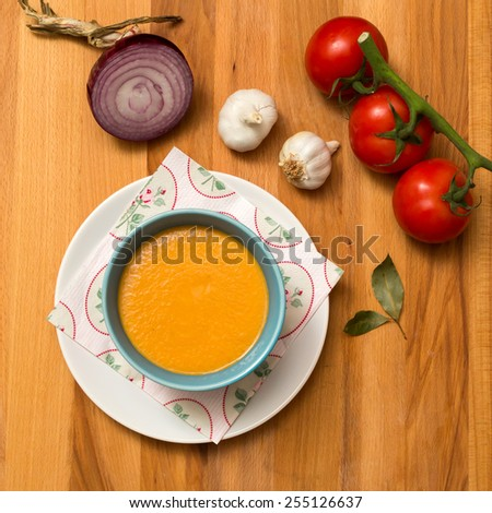 Studio shot of a healthy soup with fresh ingredients, nice vivid colors and details. - stock photo