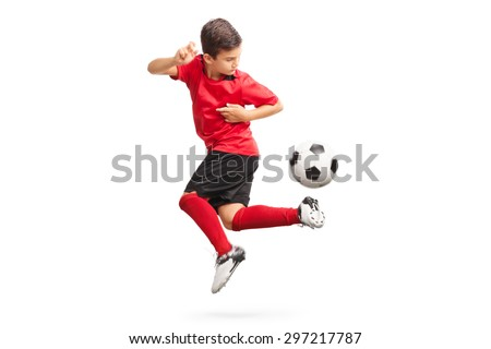 Studio shot of a junior soccer player performing a trick with a soccer ball isolated on white background - stock photo