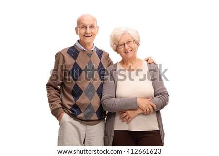 Studio shot of a lovely elderly couple posing together isolated on white background - stock photo