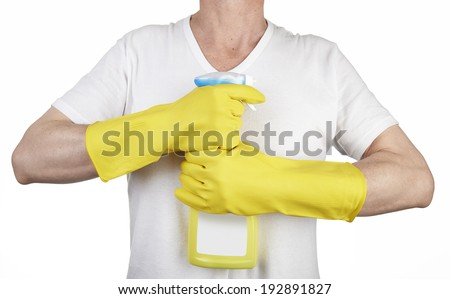 Studio shot of a man with rubber glove holding a cleaning spray bottle on white - stock photo