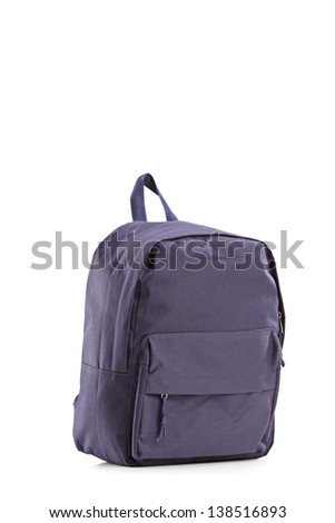 Studio shot of a navy blue closed backpack, isolated on white background - stock photo