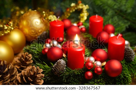 Studio shot of a nice advent wreath with baubles and one burning red candle - stock photo