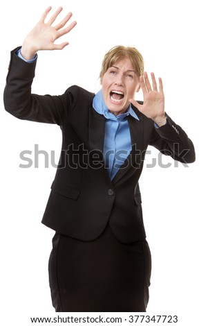 Studio shot of a Scared business woman defending herself with her arms up in the air - stock photo