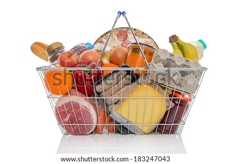 Studio shot of a shopping basket full of food including fresh fruit, vegetables, meat, pizza and dairy products. Isolated on a white background. - stock photo