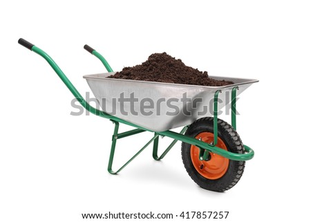 Studio shot of a wheelbarrow full of dirt isolated on white background - stock photo