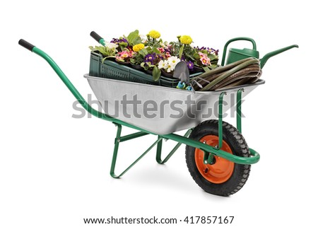 Studio shot of a wheelbarrow full of gardening equipment and flowers isolated on white background - stock photo