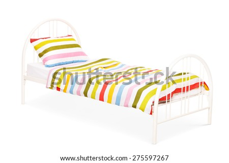 Studio shot of a white bed with a blanket and a pillow on it isolated on white background - stock photo