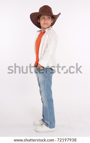 Studio shot of a young boy with a cowboy hat - stock photo