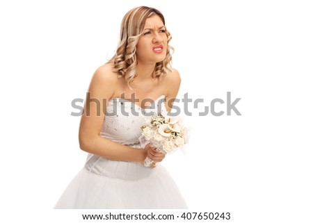 Studio shot of a young bride experiencing pain in her abdomen isolated on white background - stock photo