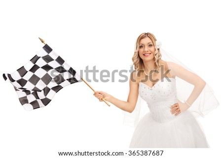 Studio shot of a young bride waving a checkered race flag and looking at the camera isolated on white background - stock photo