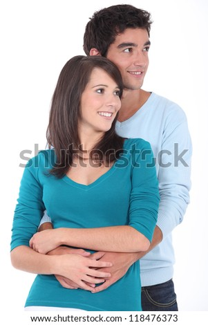 Studio shot of a young couple - stock photo