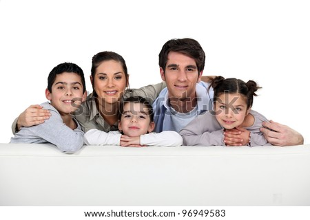 Studio shot of a young family - stock photo