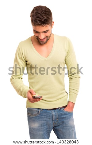 Studio shot of a young handsome man at the phone - stock photo