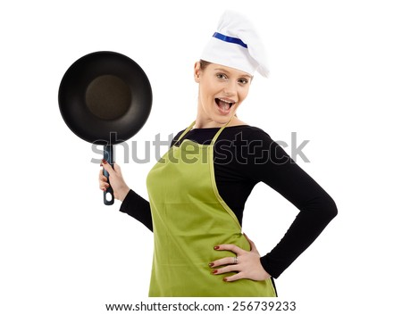Studio shot of a young woman cook holding a wok pan isolated on white background - stock photo