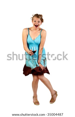 studio shot of a young woman having a glass of wine and dancing - stock photo
