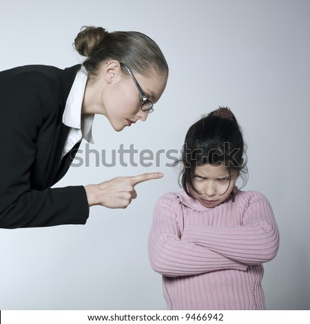 studio shot of a young woman having problem educate her child - stock photo