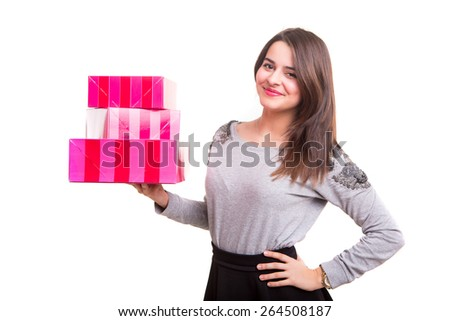 Studio shot of a young woman holding some gifts, isolated over white - stock photo