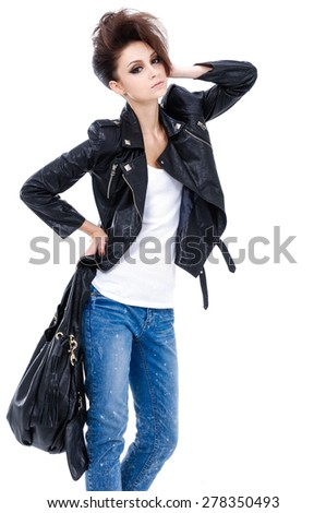 Studio shot of a young woman with bag posing - stock photo