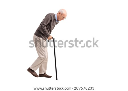 Studio shot of an exhausted old man walking with a cane isolated on white background - stock photo