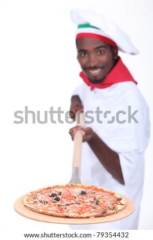 Studio shot of an Italian pizza chef - stock photo