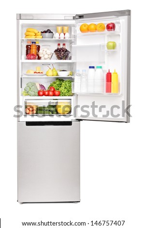 Studio shot of an open fridge full of healthy food products isolated on white background - stock photo