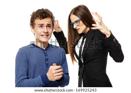 Studio shot of angry menacing teacher threatening student, isolated over white background - stock photo