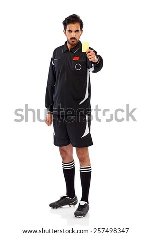 Studio shot of angry young football referee showing yellow card on white background - stock photo