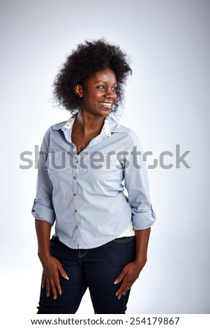 Studio shot of beautiful afro american woman looking away smiling on white background - stock photo