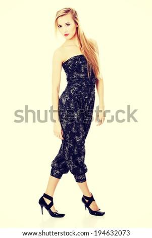 Studio shot of beautiful woman in elegant clothes. - stock photo