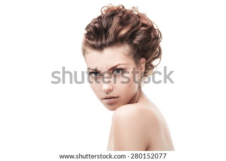 studio shot of beautiful woman with curly hair isolated over white - stock photo