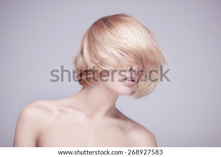 studio shot of beautiful young blond woman with clean face - stock photo