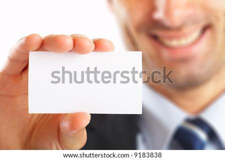 Studio shot of Businessman presenting his business card - selective focus - stock photo