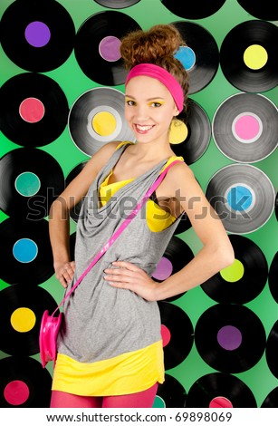studio shot of cheerful teenage girl on the colorful background - stock photo