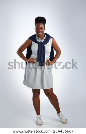 Studio shot of confident african woman posing over white background - stock photo