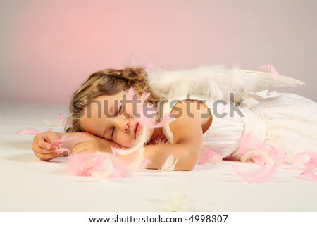 Studio shot of cute little girl as an angel. - stock photo