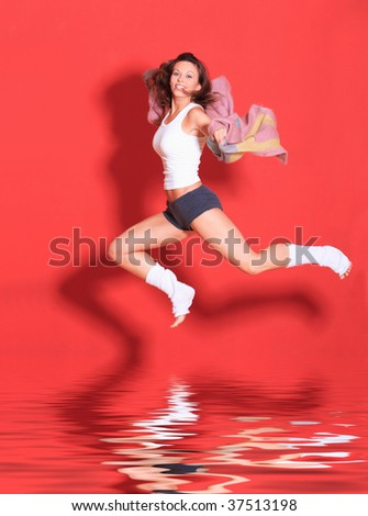 studio shot of female body in ballet pose with water reflection - stock photo