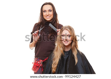 studio shot of hairdresser and young woman. isolated on white - stock photo