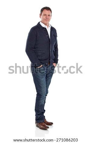 Studio shot of handsome mature man standing with his hands in pocket over white background - stock photo