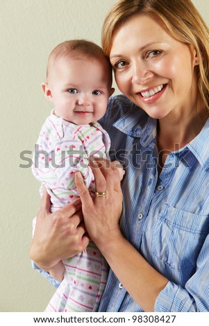 Studio Shot Of Happy Mother and Baby - stock photo