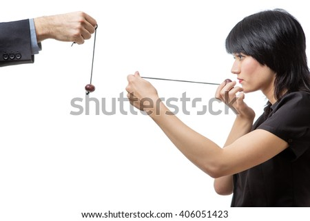 Studio shot of male and female business co-workers having a game of conkers, isolated on white. - stock photo