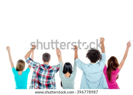 Studio shot of nice young multicultural friends. Beautiful people standing back and holding hands up. Isolated background. Free space for your logo - stock photo